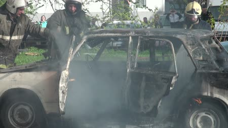 extinguishing : The burning car, extinguishing of burning car.