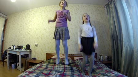 jump : Girls jumping on the bed