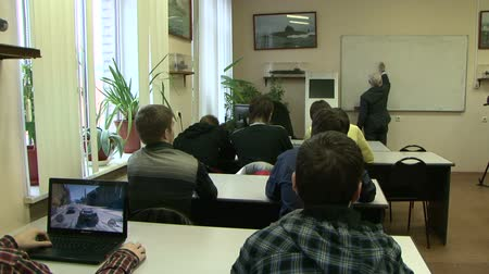 сотрудники : Students at a lecture in the classroom.
