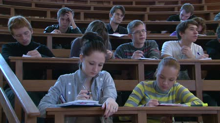 лекция : Students at a lecture in the classroom.