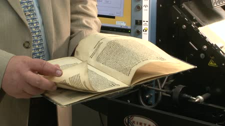 estudioso : An old book in the hands Stock Footage