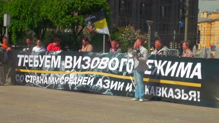 striscione : Rally per il regime dei visti in Russia Filmati Stock