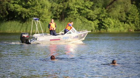 vigilant : The boat with the rescuers floating on a river Stock Footage