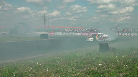 motorcar : Auto racing. The smoke from under the tires