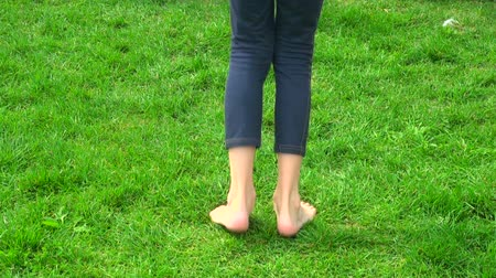 teen action : A teenager jumps on the grass