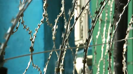 perimeter : Barbed wire for fencing criminals in the prison Stock Footage