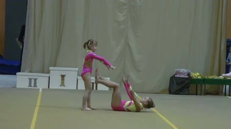 buty sportowe : Childrens competitions on acrobatics. Slow motion.