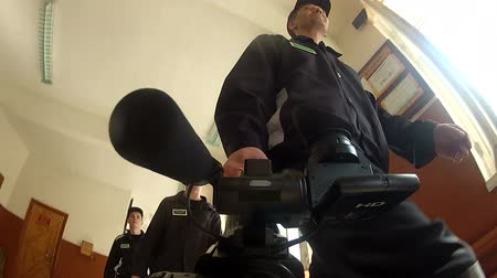 deprivation : Prisoners and convicts consider the camcorder. Stock Footage