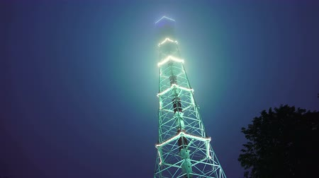 ntsc : Television tower at night decorated with fires. St. Petersburg. Fog.  Shot in 4K (ultra-high definition (UHD)), so you can easily crop, rotate and zoom, without losing quality!  Real time.