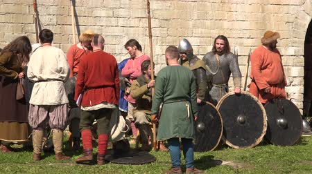 helmets : The camp of the Vikings. The Vikings before the battle. Medieval warriors. Shot in 4K (ultra-high definition (UHD)), so you can easily crop, rotate and zoom, without losing quality!  Real time. Stock Footage