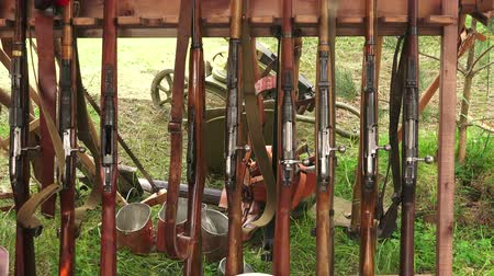 silahlar : Military warehouse rifles. The first world war. WWI. 1914-1918. Shot in 4K (ultra-high definition (UHD)), so you can easily crop, rotate and zoom, without losing quality!  Real time. Stok Video