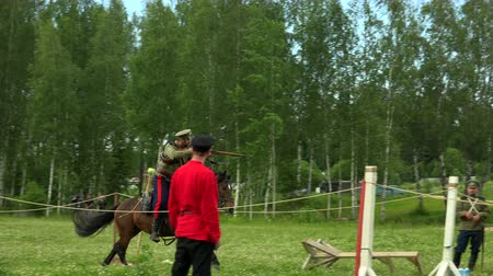wwi : Russian soldier riding a horse and shoots. WWI. 4K. Stock Footage