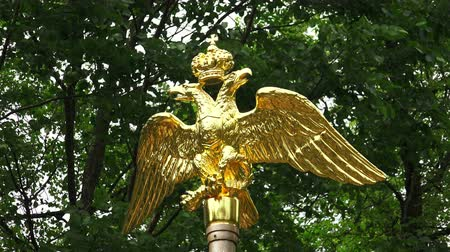 regal : The Golden double-headed eagle with a crown. Shot in 4K (ultra-high definition (UHD)), so you can easily crop, rotate and zoom, without losing quality!  Real time. Stock Footage