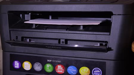 impressão digital : The printer prints the documents. Shot in 4K (ultra-high definition (UHD)