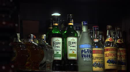 Bottle on the shelf at the bar. 4K. Stock mozgókép
