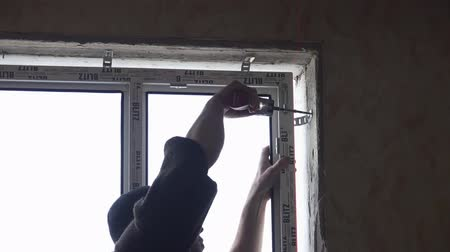 Builder installs a new window. Double glazing.