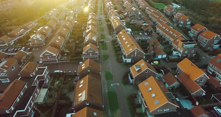 окрестности : Flying over Dutch suburb during Sunset Стоковые видеозаписи