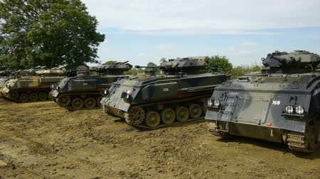 運輸 : Row of tanks lined up in field 影像素材