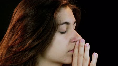 огорчен : closeup of young woman praying for help