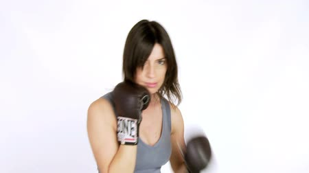 агрессивный : strong woman boxing and punching slow motion