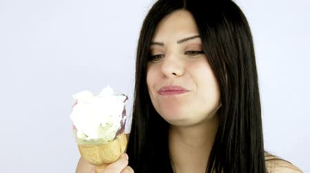comer : Gorgeous woman eating Happy big ice cream closeup