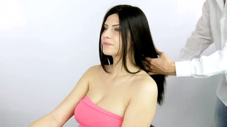 hajápoló : Amazing beautiful woman getting long hair brushed by hairdresser