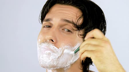 barbear : Good looking young man shaving happy closeup
