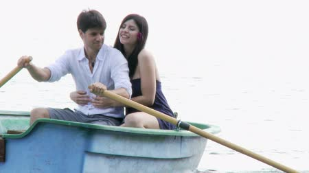romantic couple : Happy couple having fun on wood boat on italian lake Stock Footage