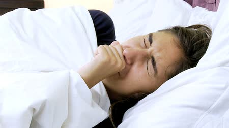 alerji : Ill woman coughing in bed with fever very sick