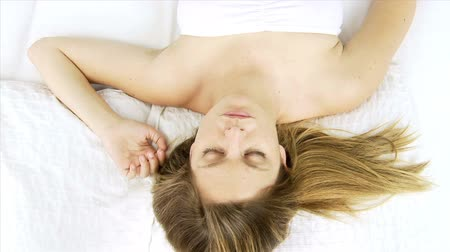 sleep : Blond beautiful woman sleeping relaxed on white bed Stock Footage