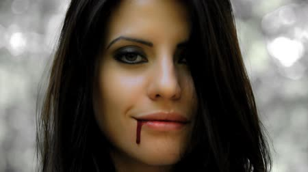 Beautiful woman vampire happy about feeding for independent movie