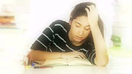 брюнет : Female student reading book falling asleep