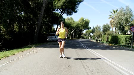fit : Gorgeous woman running on street slow motion