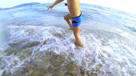 çocuk : Happy young kid running in the water Stok Video