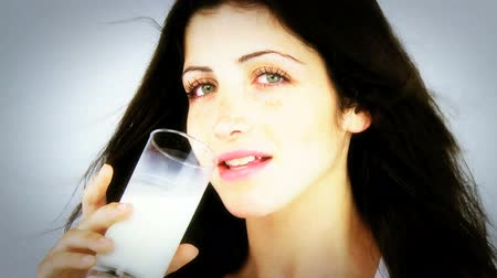 caucasiano : Beautiful female model drinking pure milk Vídeos