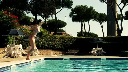 nedves : Gorgeous woman in bikini jumping in swimming pool