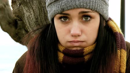 cold : Young woman with scarf and hat in the cold of autumn