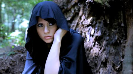 kobiety : Woman in fantasy land with hood Wideo