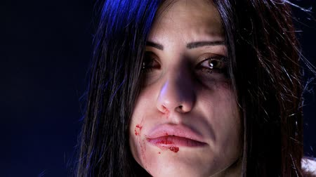evcil : Woman with blood and bruises