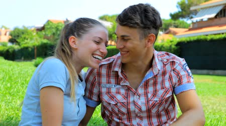 tutku : Smiling happy gorgeous lady and young man having fun in love in park