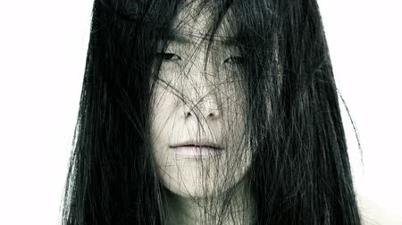 devastated : Scary depressed chinese woman closeup