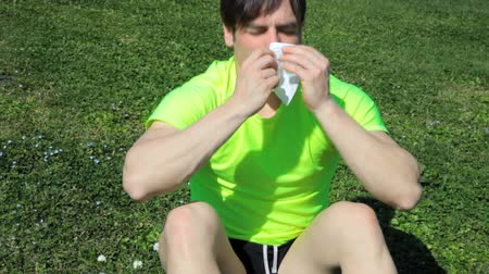 foukání : Allergic man sneezing with handkerchief