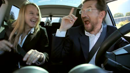 sentimentos : Cool and handsome business people having fun in car