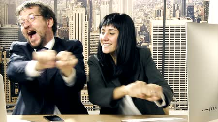career success : Business couple in love having fun dancing in office slow motion