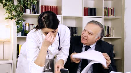 rude : Unhappy boss doctor in hospital angry with young female doctor