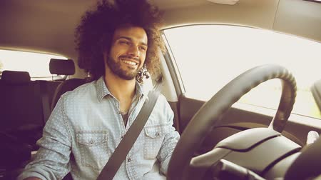 drive : Happy man driving car laughing enjoying trip Stock Footage