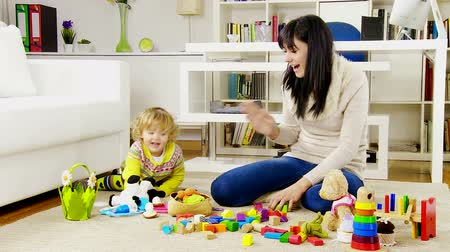 sitting room : Cute happy family playing with toys on the floor