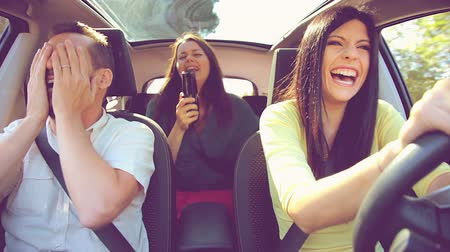 pergament : Happy people having fun in car dancing