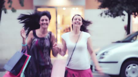 покупка товаров : Happy young women having fun shopping