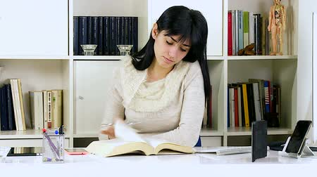 female student in college studying at desk Stock Footage
